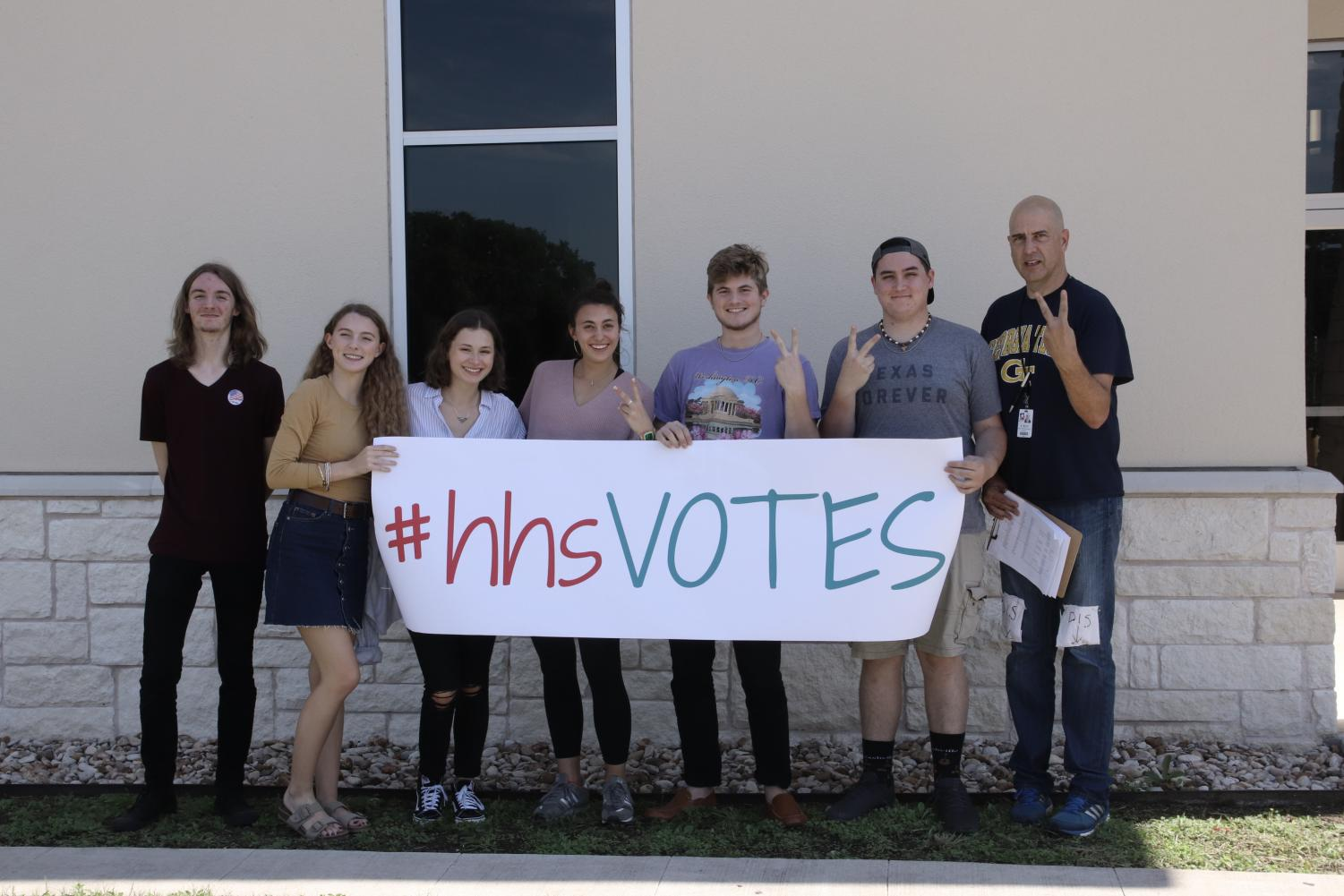 Tom Ray and several government students rode to the polls Friday.