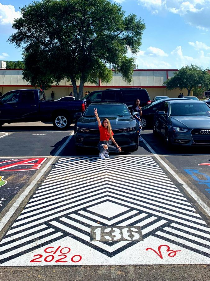 Senior+Victoria+Zapata+shows+off+her+artistically+decorated+parking+spot.