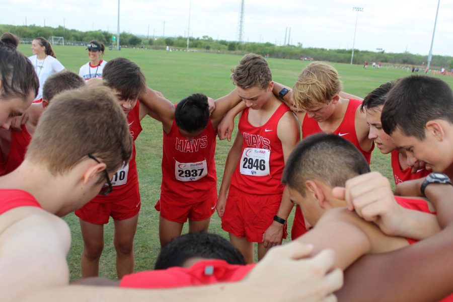 the jv boys do a prayer circle before the start of their race at the Chaps invitational