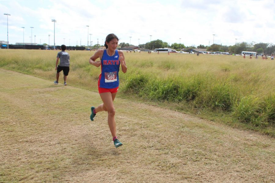 Adia Vera, 11, races toward the finish line of the regional cross country meet, which took place on Oct. 28 in Corpus Christi.