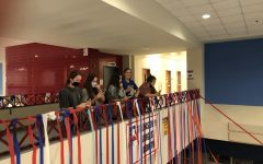 Seniors watch as Principal David Pierce enters the main hallway to witness the cup pyramids and streamers set up by seniors. The 'prank' is a yearly tradition to mark the end of the year for the graduating class.