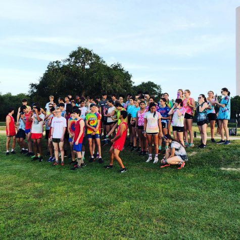 """A fun 2-mile relay took place Saturday at Hays HS. Runners brought a whimsical item to hand off to their partner in the """"race."""""""